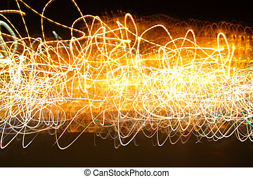 Chaotic motion of lights - abstract photo background -...