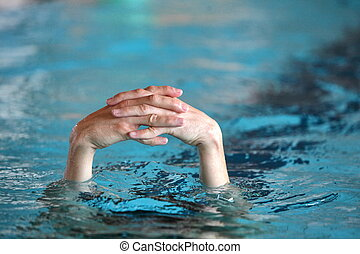 folded hands above water - two folded hands above water -...