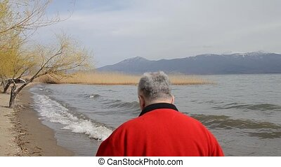 Man walking on a beach of Lake Prespa, Macedonia - Video of...