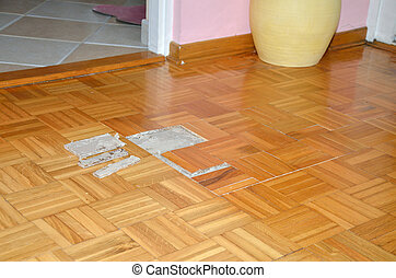 Floor in Apartment with Damaged Parquet