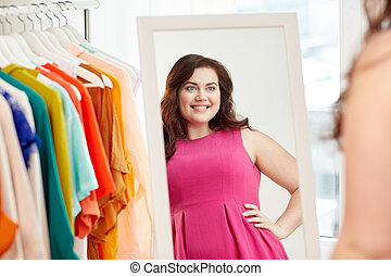 happy plus size woman posing at home mirror - clothing,...