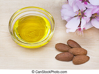 Almond oil in a glass dish
