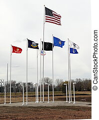 Flags fly at the Fields of Honor Military Veterans Museum -...