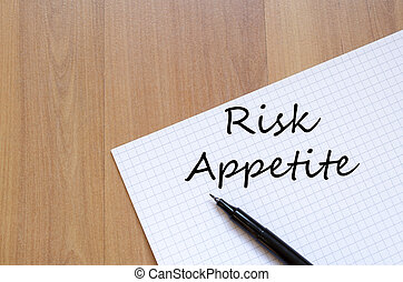 Risk appetite write on notebook - Risk appetite text concept...