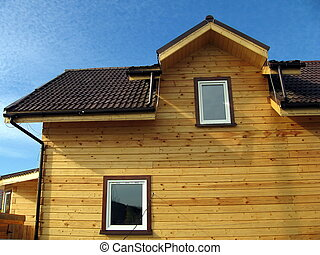 Wood house - Very beautiful new wood house on a background...