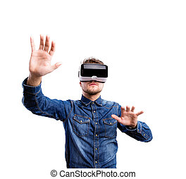 Man wearing virtual reality goggles - Hipster man in denim...