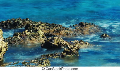 Waves breaking on the coral reef. Concept - time is fast -...