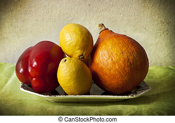 Lemons and vegetables in chiaroscuro