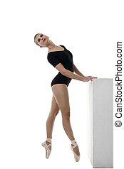 Image of artistic ballerina dancing in studio