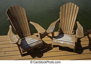 Used Adirondack chairs - Well used old adirondack chairs on...