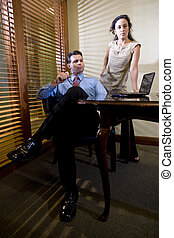 Hispanic office worker working with male colleague