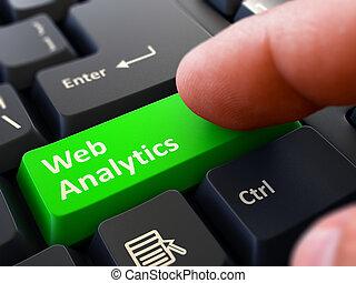 Web Analytics - Written on Green Keyboard Key. Male Hand...