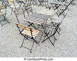 Outdoor cafe with wooden tables and chairs