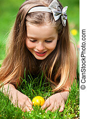 Child search easter egg outdoor. - Happy little girl look...