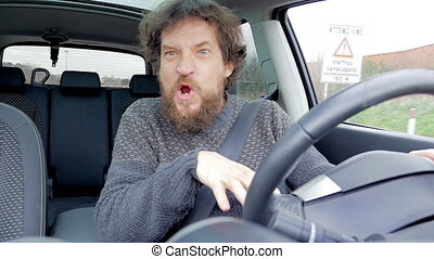 Happy hipster man dancing and singing in car looking camera...