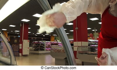 Shoe supermarket shelves with a damp cloth. Cleaning of...