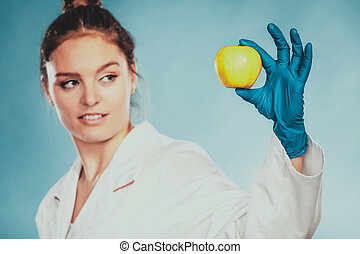 Scientist doctor with rotten apple. GM food. - Scientist...