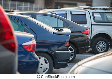 cars in a row on a parking lot