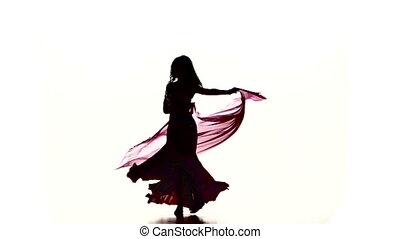 Pretty young woman go on dancing belly dance with colored...