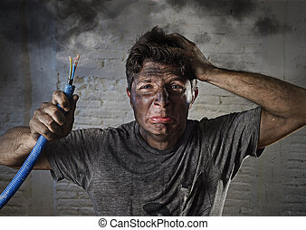 young man holding cable smoking after electrical accident...