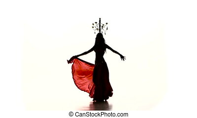 Belly dancer woman starts dancing with burning candles on...