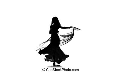 Pretty young woman go on dancing belly dance with shawl,...