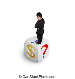 Businessman standing on dice of dollar sign and punctuation...