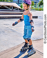 Girl riding on roller skates - Girl wearing protection...