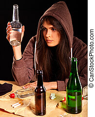 Drunk girl holding bottle of vodka. - Drunk girl in hood...