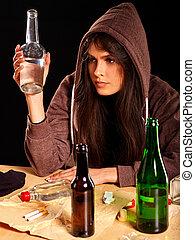 Drunk girl holding bottle of vodka. - Drunk girl in hood...