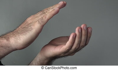 Man hands clapping on a grey background. Concepts and ideas...