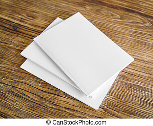 Blank catalog, magazines,book mock up on wood background