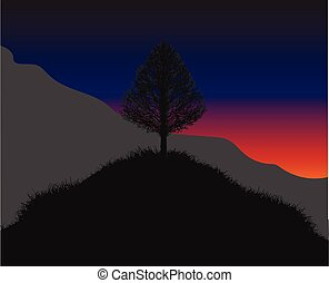 Hill with a lonely tree on the top