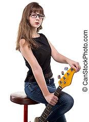 Proud teenage girl sitting on bar stool on white background