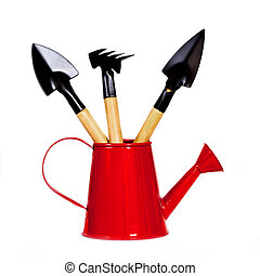 garden tool in red watering can.