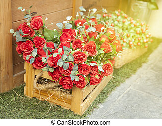 Red roses flower bouquet in wood box on floor with soft...