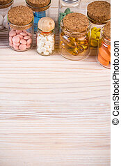 Medical background with pills in containers