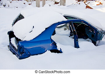 Wasted car under snow - Wasted blue car under white snow in...