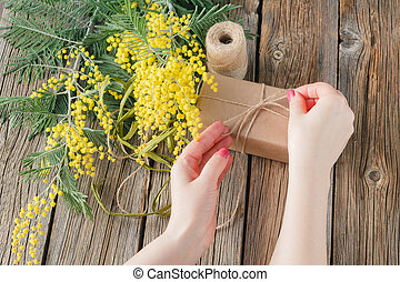 Woman make gift box. - Woman hands make gift box. Present...