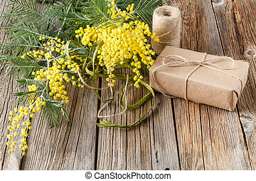 top view paper wrapped gift with yellow spring flowers