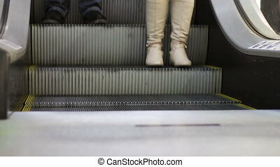 Anonymous People Walking on the EscalatorLift in Shopping...