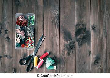 Sewing accessories on wooden table