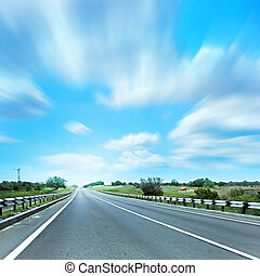 on the road - beautiful blue shining sky and leaving to...