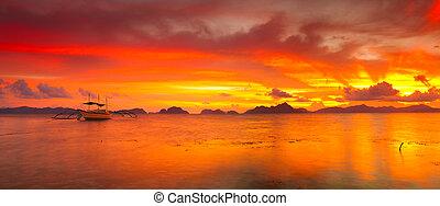 Boats at sunset. Panorama