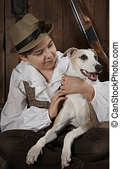 Little hunter boy with a dog - Little hunter boy hugs his...
