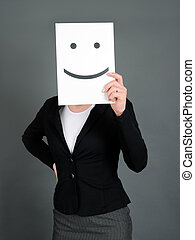 Smiley face - Woman holding a paper with smiley face