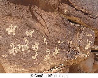 Petroglyphs  - Ancient Petroglyphs carved into rock in Utah