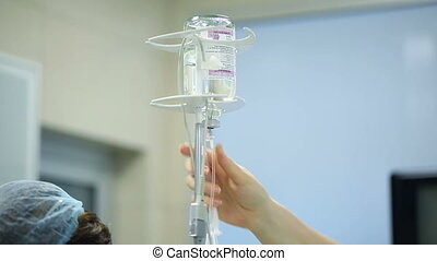 Dropper in the operating room - Dropper with medication in...