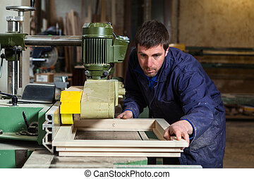 Carpenter man working with tablesaw in workshop - Portrait...