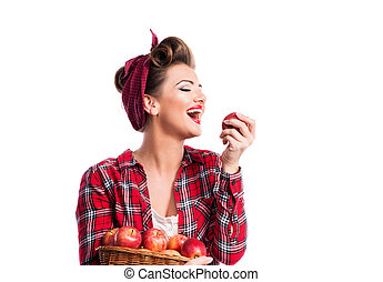 Woman, pin-up hairstyle holding basket, eating apple Autumn...
